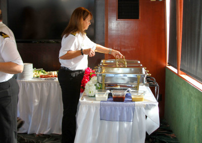 Ms. Connie taking care of the buffet..