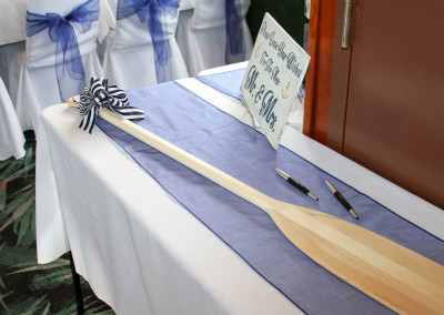 Well wishes...guests sign the oar for bride and groom..