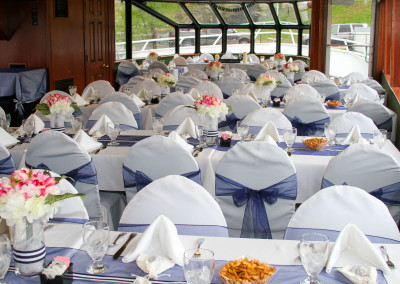 white Linens with blue sashes..